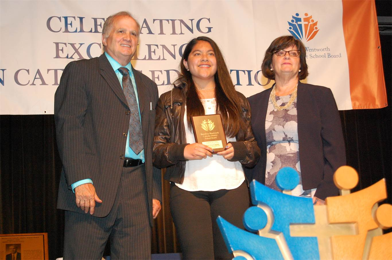 Grade 8 St. Clare of Assisi student Ania Vera Laguna is presented with a Living the Spirit Award by Trustees Paul DiFrancesco and Mary Nardini. The Award recognizes exemplary, well-rounded students.
