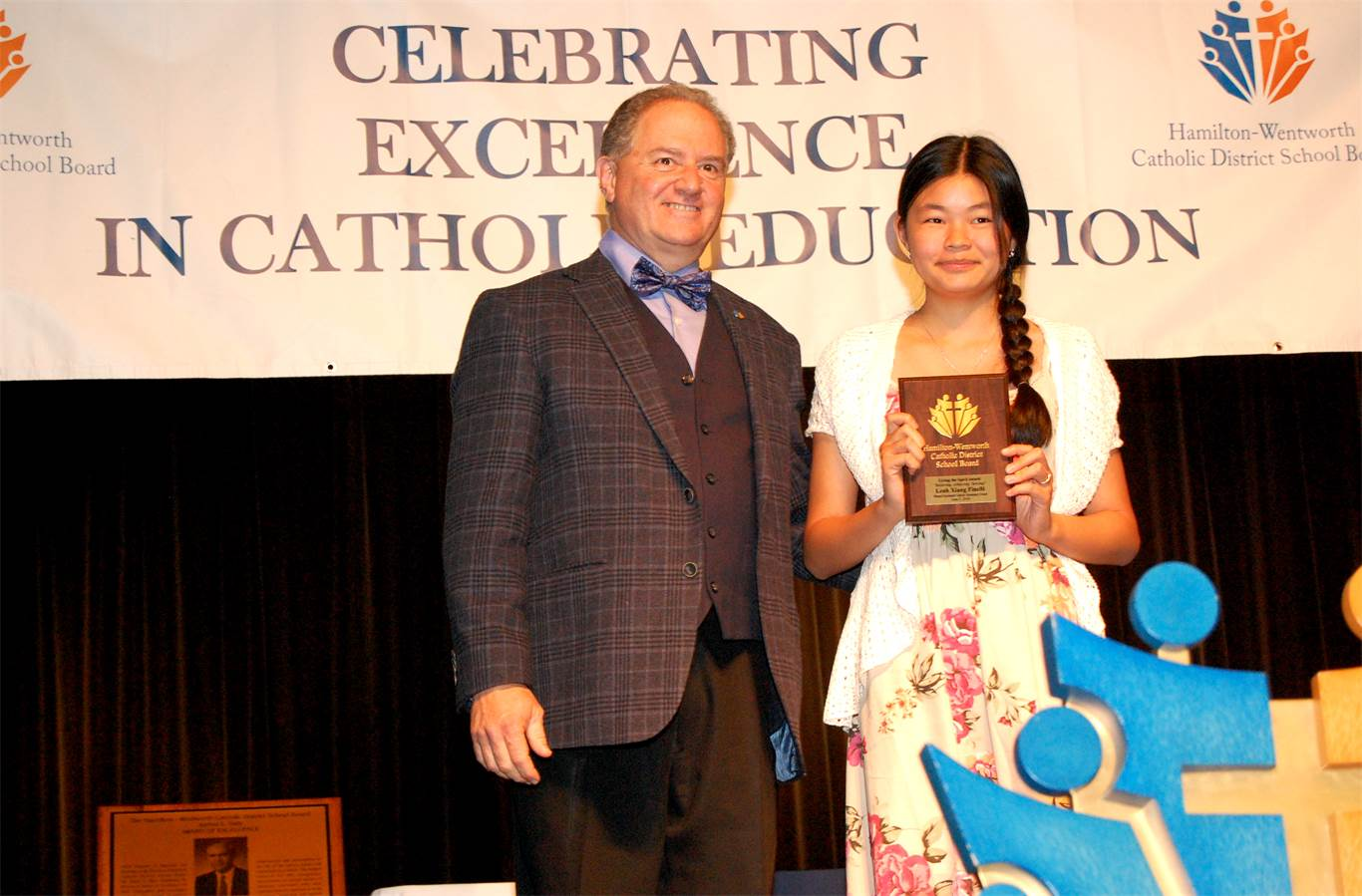 Grade 8 Blessed Sacrament student Leah Xiang Finelli is presented with a Living the Spirit Award by Trustee Joseph Baiardo. The Award recognizes exemplary, well-rounded students.